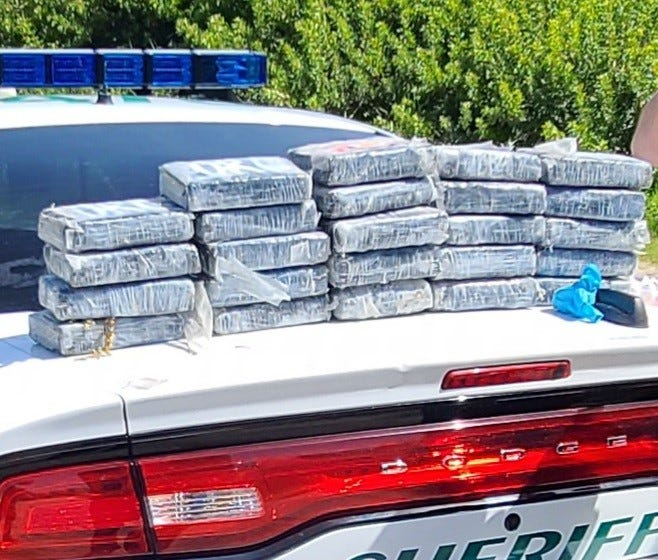 Packages of cocaine that washed ashore on Cape Canaveral Space Force Station are seen after recovery in May 2021.
