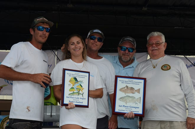 Team Relentless collects their plaque and $1,250 in prizes for winning the grouper category of the Florida Sport Fishing Association Offshore Slam on June 5, 2021.