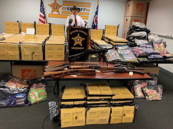 Sheriff Richard K. Jones stands behind a large amount of drugs seized on Wednesday June 9 in Butler County.