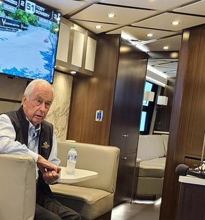 Roger Penske answers media questions in his Team Penske trailer at the Chevrolet Detroit Grand Prix.