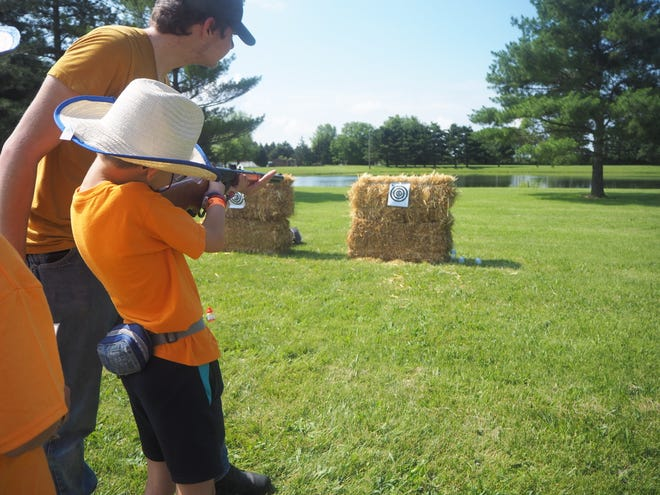 """Cowboy Camp mixes """"cowboy"""" skills such as target shooting with BB guns along with Bible lessons."""