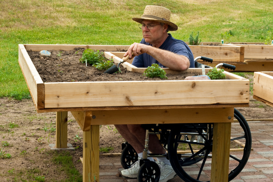 An enabled garden includes features that cater to the gardener's physical abilities.