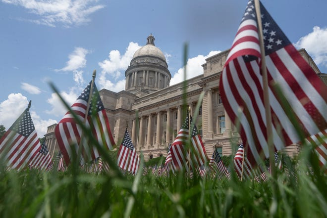 Flags cover the lawn of the Kentucky Capitol in memory of all the victims of COVID-19 who died in the state. June 11, 2021