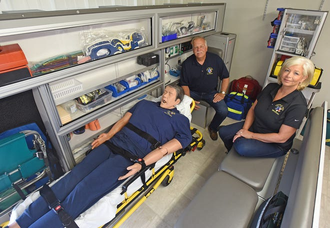 Ron Henry and Angie Hoptry Henry pose for a photo in Central Ohio EMS Training's simulated ambulance.