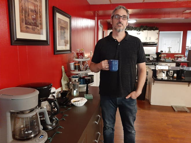 Dwayne Castle has an espresso machine and a full coffee bar in the Galion home he shares with his wife, Deborah.
