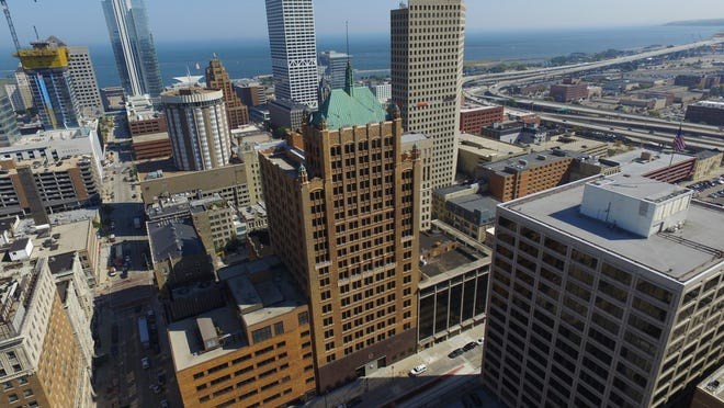 AT&T Inc.'s downtown Milwaukee office tower (center) and its mid-rise addition (left) have been sold for $30.1 million.