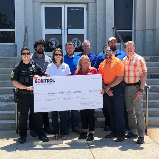 Sonitrol of Muncie donates a large sum of money to the Muncie Police department to help replace their K-9, who will be retired due to old age. Several local groups including Greg Hubler Ford and the Ball Brothers Foundation helped raise funds for a new K-9 for the department.