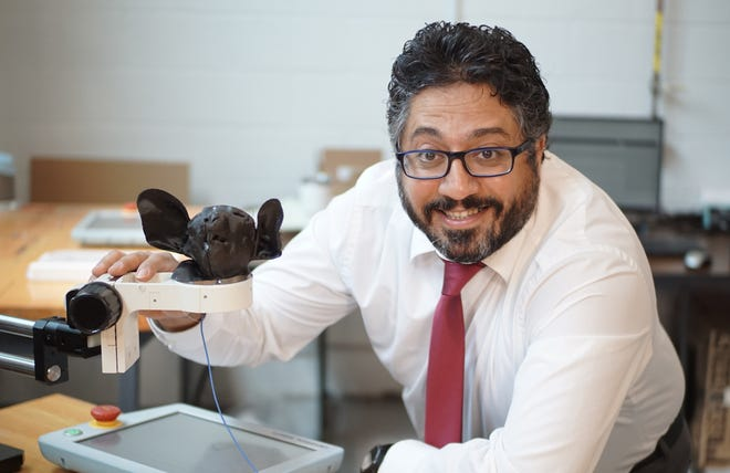 Ehsan Dehghan-Niri, assistant professor in the Department of Civil Engineering at New Mexico State University, stands next to a 3D printed aye-aye biometric system used to simulate tap scanning. Niri received the 2021 National Science Foundation Faculty Early Career Development award earlier this year.