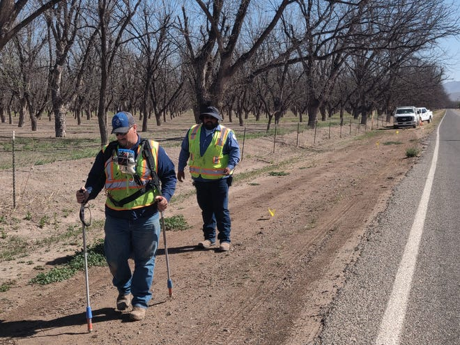 Natural Gas Cathodic Technicians Stephan Klingelmeier and Jesus Roman performing an incremental survey on a gas transmission line by inducing the current to maintain the integrity of the gas system.