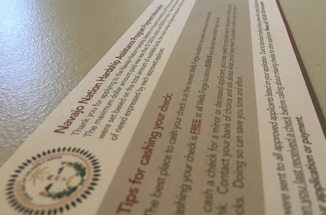 Recipients of checks issued under the Navajo Nation CARES Fund Hardship Assistance Program received instructions for cashing payments.