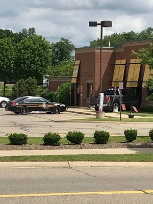 Police said a driver fainted and drove into the side of the New Hudson Applebee's restaurant June 8.