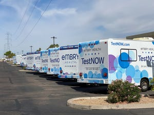 Embry Health mobile units sit parked by their Phoenix office. The company is waiting to send them out until it's in good standing with the state health department.