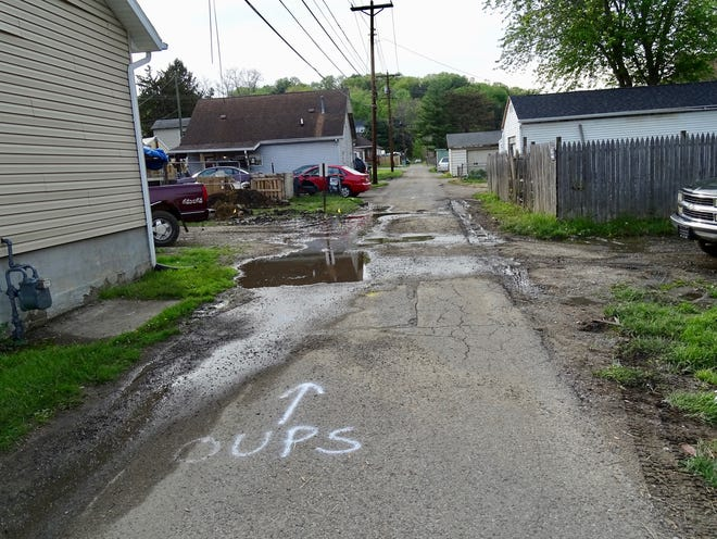 Crews marked where an apparent sewer line runs along Brown Alley in Licking View when it flooded in early May. The flooding issue is temporarily at bay, but it's widely agreed that a new, permanent sewer is needed — and residents say it's long overdue.