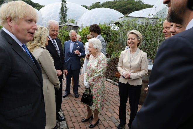Queen Elizabeth II speaks to President Joe Biden and his wife Jill Biden, with Prime Minister Boris Johnson (left) and Prince Charles (center) during a reception with the G7 leaders at the Eden Project in Cornwall, England, June 11, 2021.