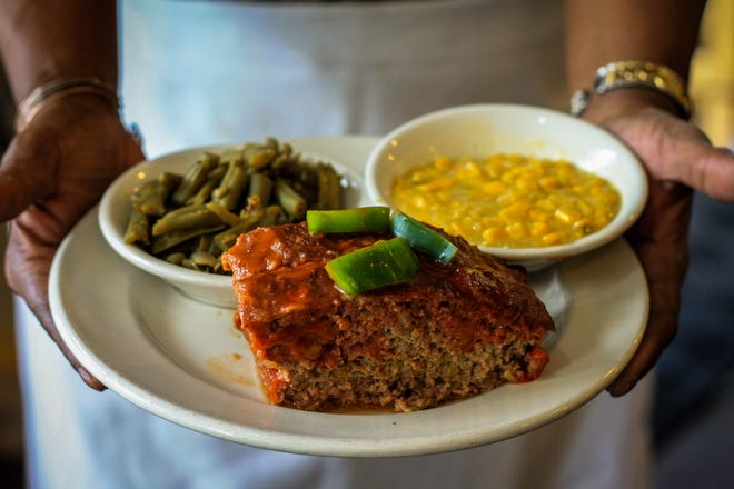 """""""I think about the collard greens and cornbread, peas and rice, okra and tomatoes, sweet potatoes, and many other foods I love and that take me back to my grandmother's kitchen with warm memories,"""" Moore says."""