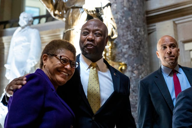Rep. Karen Bass (D-CA), Sen. Tim Scott (R-SC), and Sen. Cory Booker (D-NJ) leave a meeting about police reform on May 18, 2021. Talks later broke down, and Scott blamed Democrats for the failure.