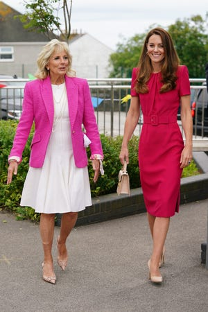 First lady Jill Biden and Duchess Kate wore pink and red outfits to visit Connor Downs Academy in Cornwall on June 11, 2021.