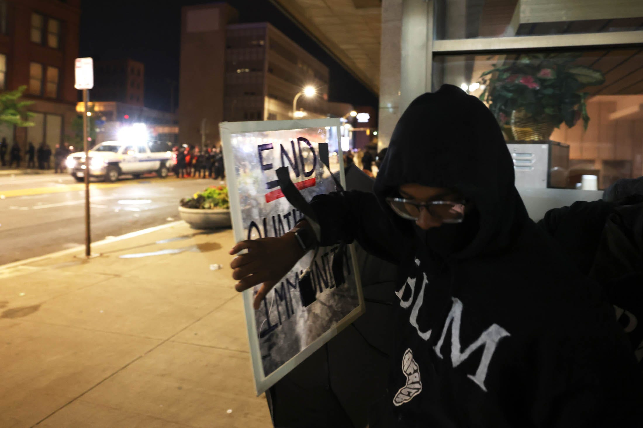 A demonstrator rallies for police reform in September 2020 in Rochester, New York, after the death of Daniel Prude at the hands of police.