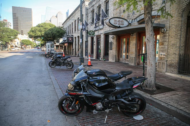 Abandoned bikes in the 400 block of Sixth Street in Austin, where a man shot and wounded 13 people on June 12.