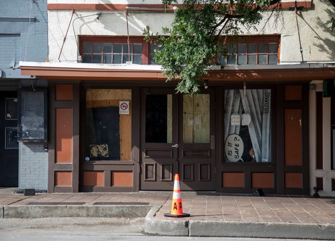 """A sign in a window reads """"Is it safe?"""" along 6th Street. Thirteen people were injured during a shooting that occurred early Saturday morning in downtown Austin."""