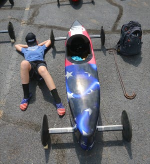 Colt Nelman, 11, rests before the start of the stock division race at the 83rd Akron Local Soap Box Derby on Saturday at Derby Downs in Akron.