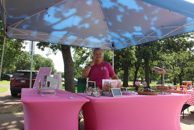 Carol Resz, owner of the Pink Kitchen Home Bakery, in her booth at  the Market at Whittington.