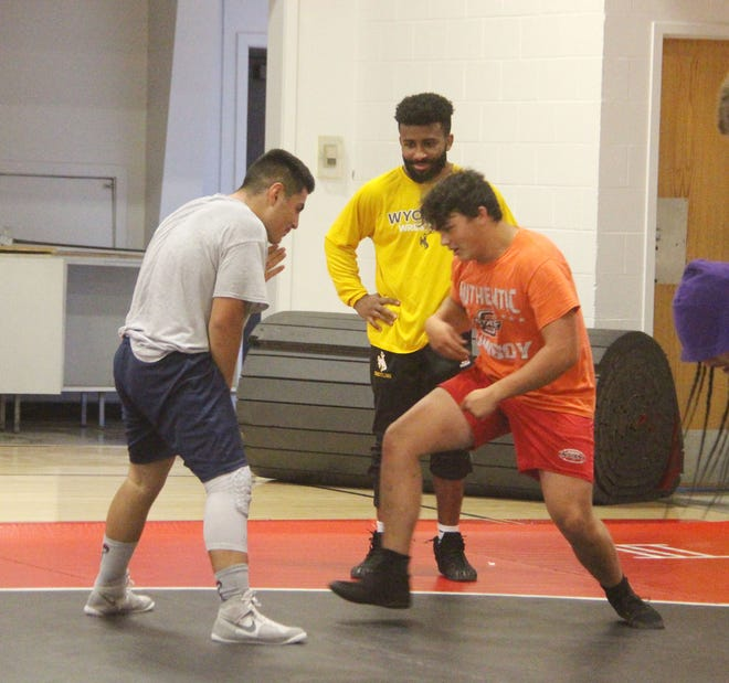 Montorie Bridges looks on as two grapplers square off during a drill at the inaugural Plainview wrestling camp.