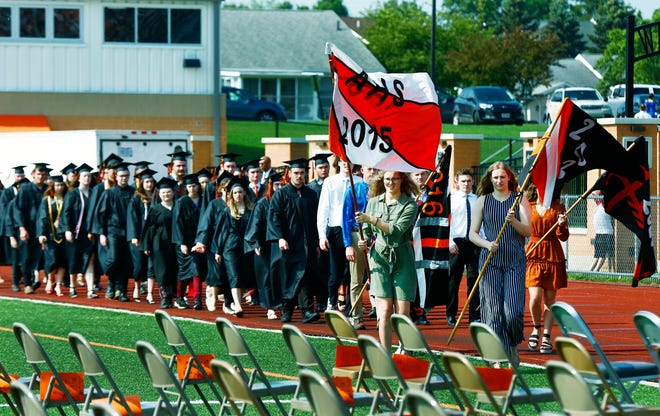 Graduates march in the processional for the Ashland High School graduation ceremony in Community Stadium on Saturday. NOELLE BYE/FOR TIMES-GAZETTE.COM