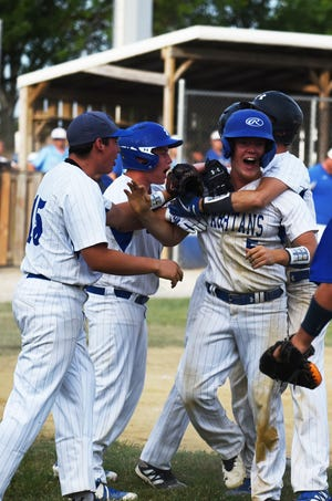Collins-Maxwell's William Booth (5) gets mobbed by his teammates after scoring the winning run in the bottom of the seventh inning for the Spartans in their 8-7 comeback over Colo-NESCO Friday at Collins.