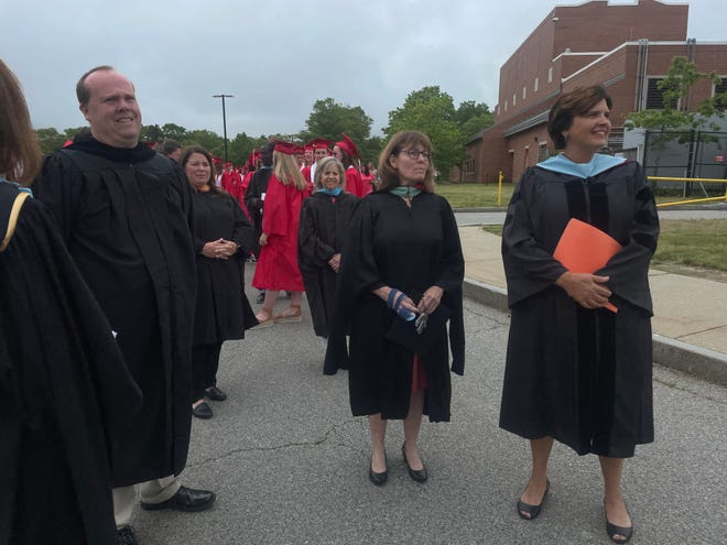School Committee Chairman Mike Judge, Vice Chair Kathy Bent, and Supt. Meg Mayo-Brown at the BHS commencement last spring.
