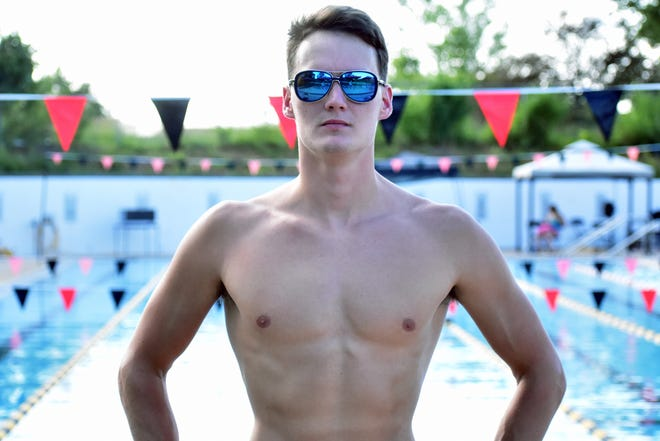 Former Missouri swimmer Nick Alexander poses for a photo Thursday at the Macher Aquatic & Fitness Center in Columbia.