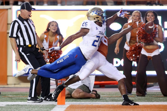Texas receiver Devin Duvernay (6) cannot catch a pass defended by Tulsa cornerback Akayleb Evans (26) during a game Sept. 8, 2018, at Darrell K Royal-Texas Memorial Stadium in Austin, Texas.