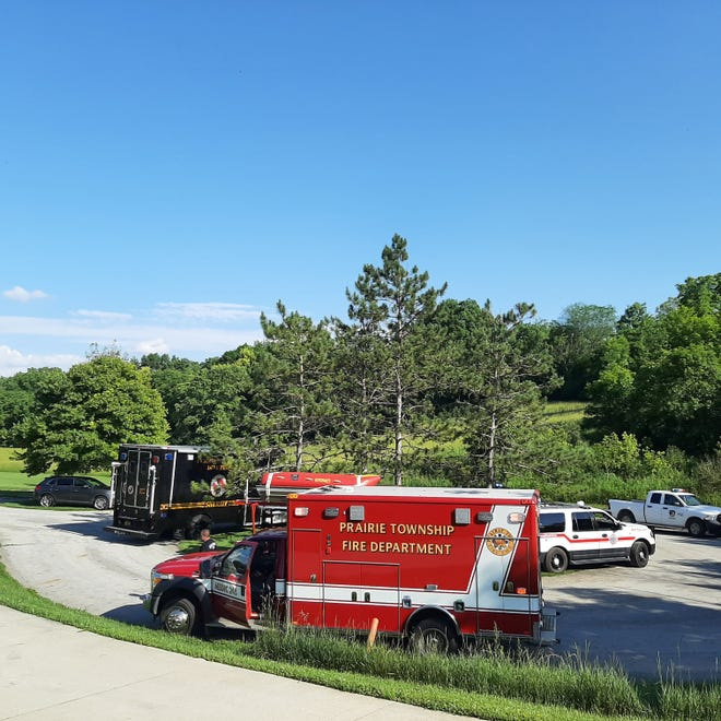 Fire and rescue crews and law enforcement packed a parking lot along Alkire Road at the Battelle Darby Creek Metro Park Saturday afternoon and into Sunday as divers and rescuers in boats looked for a man who went missing in the water.