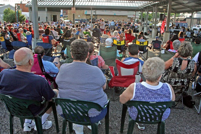 A large audience listens to the Adrian City Band while it performs July 12, 2018, at the Adrian Farmers Market pavilion on Toledo Street. The band will begin its 2021 summer season at the farmers market before moving to the pavilion at Trestle Park.