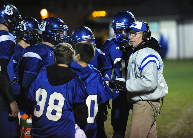 Evening News photo by BRYAN BOSCHDundee head coach Ed Maloney talks to his team on the sidelines during a home game against Ida.