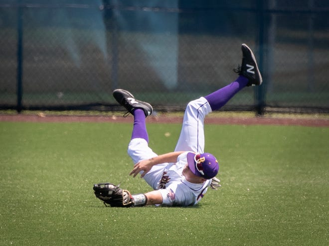 Blissfield's Ethan Stines made a diving catch in center field during Saturday's Division 3 regional final at Grosse Pointe Woods University Liggett.