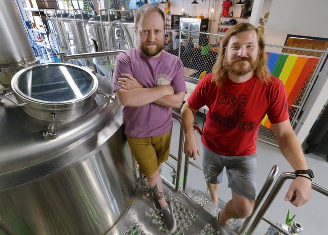 Erie Ale Works co-founders Steve Anthony, left, and Jeff McCullor are shown on June 12 inside the West 12th Street brewery in Erie.