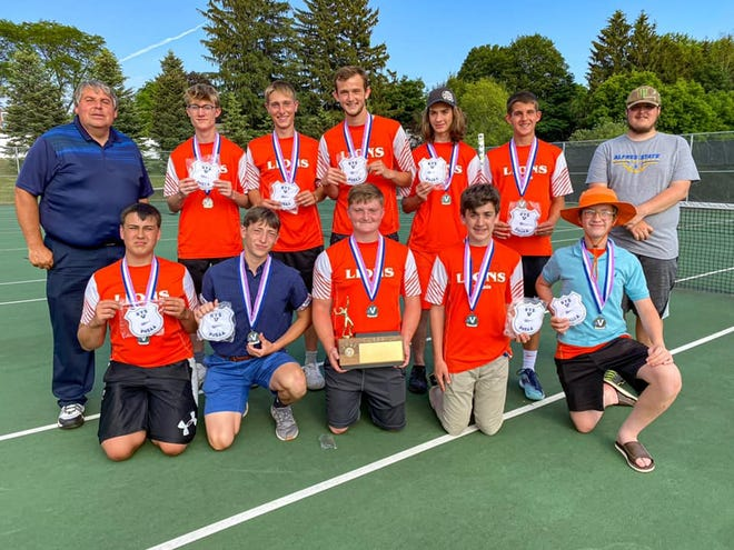 The Wellsville tennis team celebrates after winning the first Section V title in program history Friday evening in LeRoy.