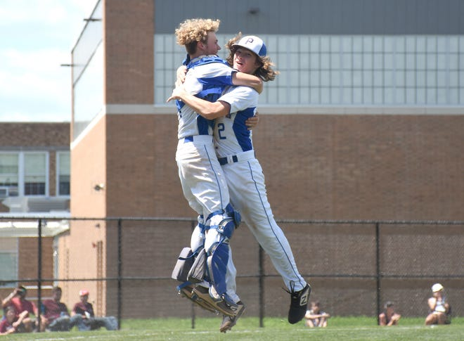 Catcher Kade Ozog and pitcher Isaiah Zuchowski (from left), senior teammates on Poland's baseball team, leap into each other's arms after recording the final out of Section III's Class D championship game Saturday against DeRuyter on their home field in Poland.