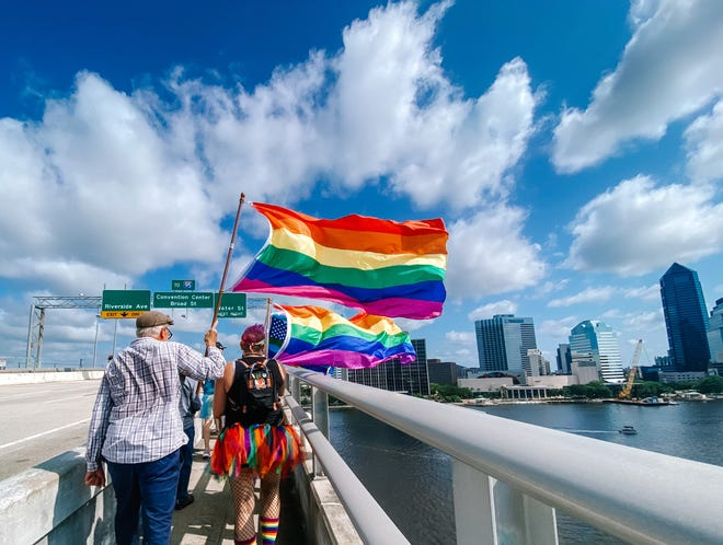 Days after the Acosta Bridge Pride lighting controversy, hundreds from Jacksonville's LGBTQ+ community and their supporters — many with rainbow flags — marched across the 1,645-foot-long bridge spanning the St. Johns River in downtown. On Tuesday, a day after the Jacksonville Transportation Authority debuted the Pride lighting scheme using the bridge's LED lighting system, the state forced the local authority to discontinue the display, creating an outcry from many in the community. On Wednesday, the Pride lights returned to the bridge for their scheduled week-long display.