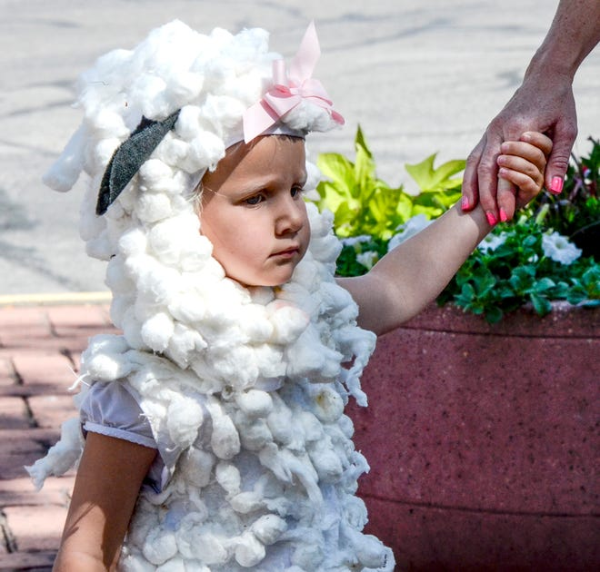 Sage Anderson wore a lamb costume in the Beef Empire Days United Wireless Children's Parade Friday.