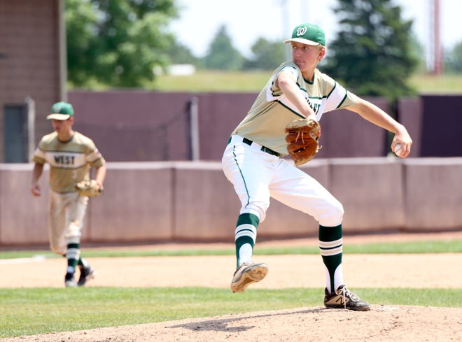Zeeland West's Josh Agar throws a pitch during the regional title game