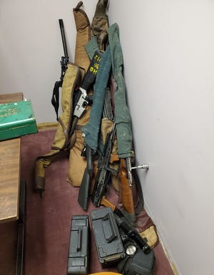 This cache of weapons, including some hidden in a wall, were seized during a raid by Barton County law enforcement on Thursday.