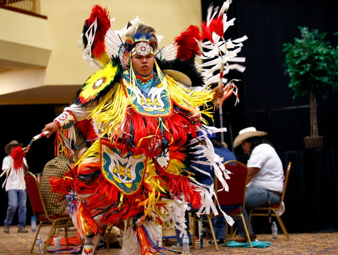 Daniel Scholfield, who is Potawatomi, dances Saturday during the Red Earth Festival.