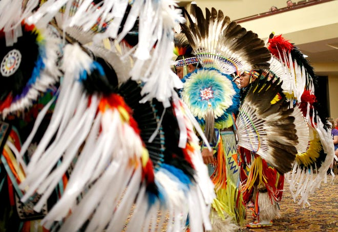 Dancers participate in the grand entry of dancers Saturday during the Red Earth Festival at Grand Casino & Hotel Resort in Shawnee.
