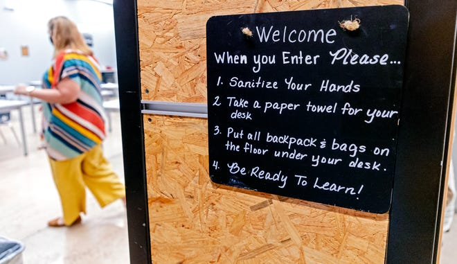 A sign posted outside an art classroom for students returning to class at Santa Fe South High School in Oklahoma City on Aug. 12. Santa Fe South Charter Schools were among the first to reopen face-to-face in the Oklahoma City metro area for the 2020-21 school year.
