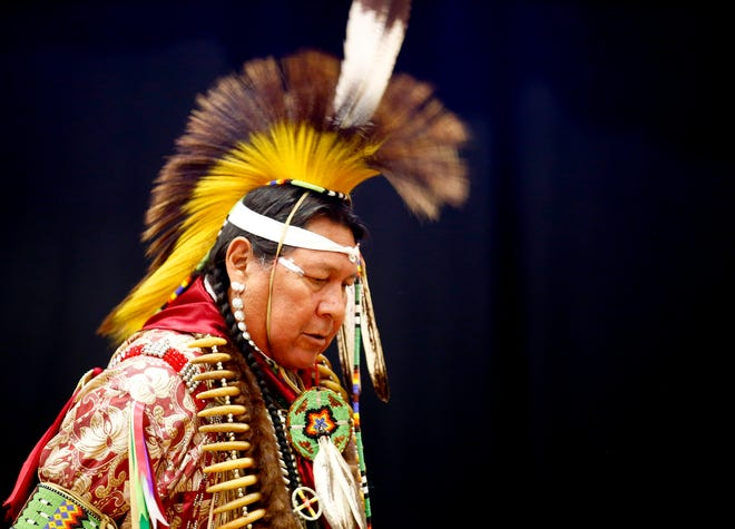 Henry Hunter, who is Sac & Fox, dances Saturday during the Red Earth Festival.
