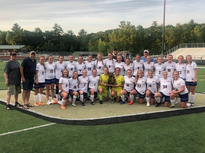 The Boyne City girls' soccer team shows off the Division 3 regional championship trophy in Comstock Park Friday night after defeating Big Rapids by a 2-1 score.