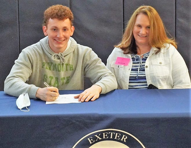 Exeter High School senior Zach Gilvar, left, will play men's lacrosse next year at Plymouth State University. Gilvar is seated with his mother Debra. The Stratham resident plans to major in marketing.