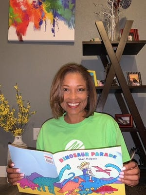 "Florida Power & Light Company employee Barbara Thompson read ""Dinosaur Parade"" by Shari Halpern in Jupiter."